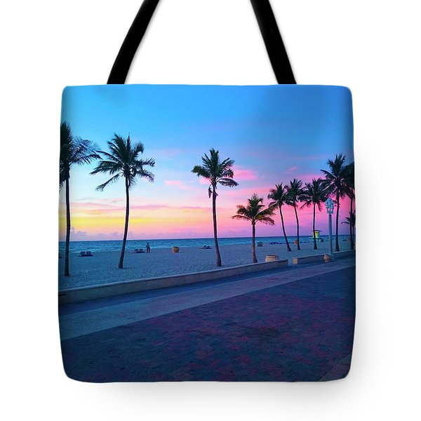 Tote Bag featuring the photograph Strolling Along The Beach Under A Majestic Sunset by Patricia Awapara
