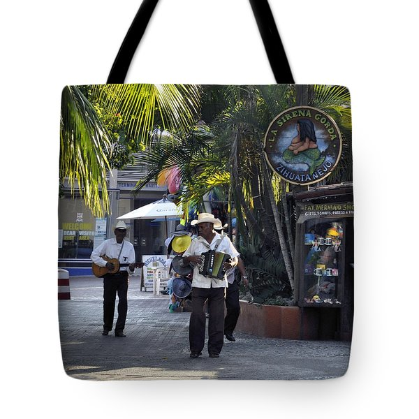 Tote Bag featuring the photograph Strolling Musicians by Jim Walls PhotoArtist