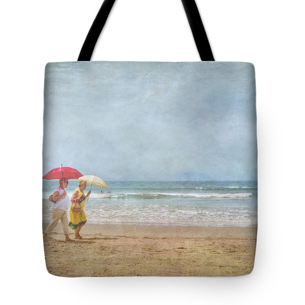 Tote Bag featuring the photograph Strolling On The Beach by David Zanzinger