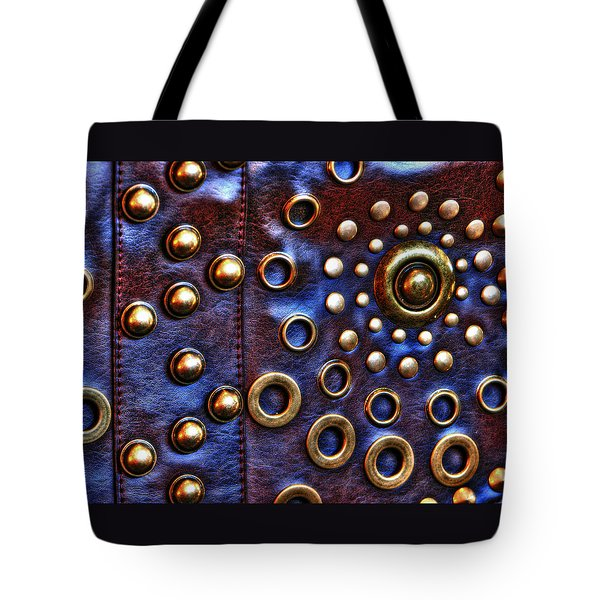 Tote Bag featuring the photograph Studs On Leather by Chris Anderson
