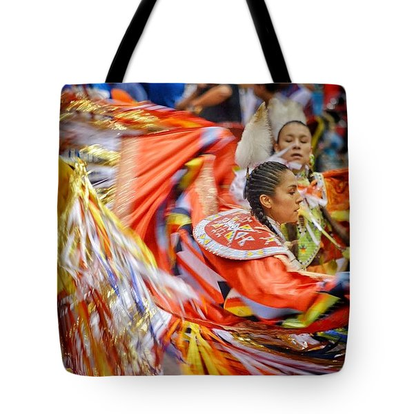 Tote Bag featuring the photograph Fancy Shawl Dancers 3 by Clarice Lakota