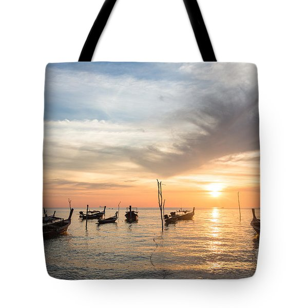 Stunning Sunset Over Wooden Boats In Koh Lanta In Thailand Tote Bag