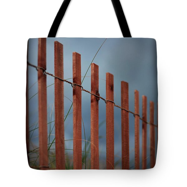 Tote Bag featuring the photograph Summer Storm Beach Fence by Laura Fasulo