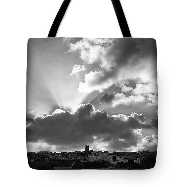 Sun Beams Over Church Tote Bag by Nicholas Burningham