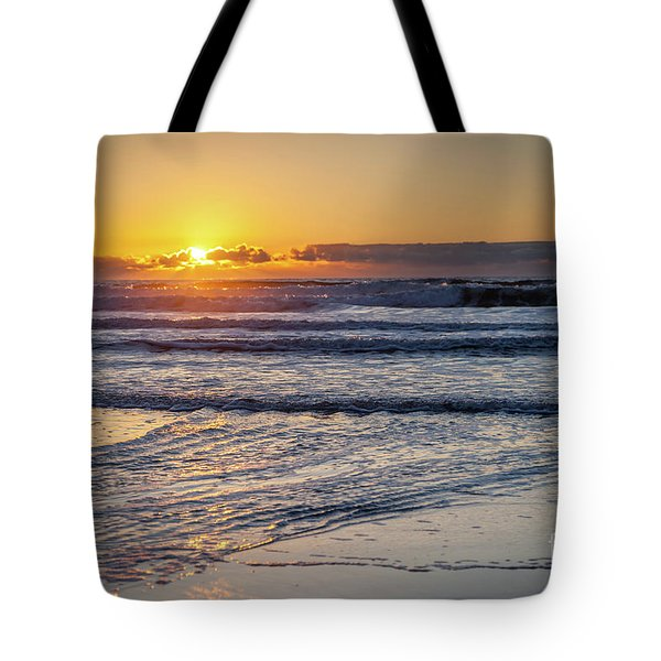 Sun Behind Clouds With Beach And Waves In The Foreground Tote Bag