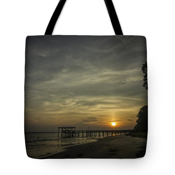 Sun Going Down Behind Dock Tote Bag