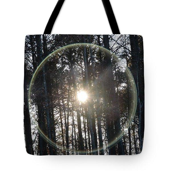 Sun Or Lens Flare In Between The Woods -georgia Tote Bag