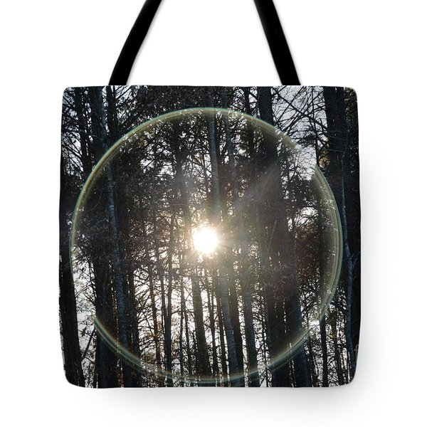 Sun Or Lens Flare In Between The Woods -georgia Tote Bag