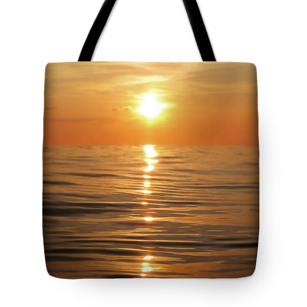 Sun Setting Over Calm Waters Tote Bag