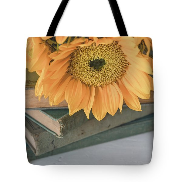 Tote Bag featuring the photograph Sunflowers And Books by Kim Hojnacki