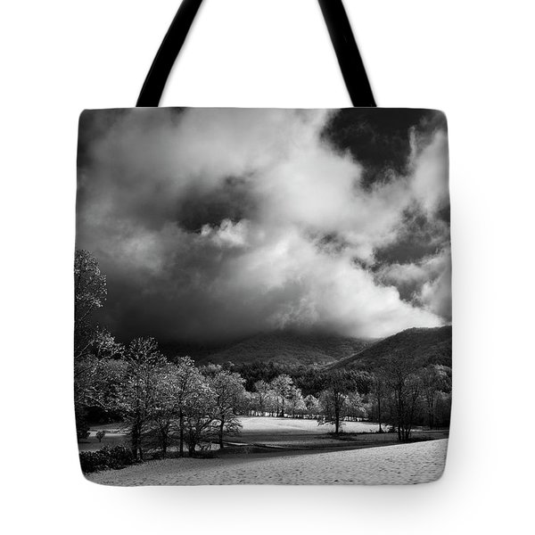 Sunlight Clouds And Snow In Black And White Tote Bag