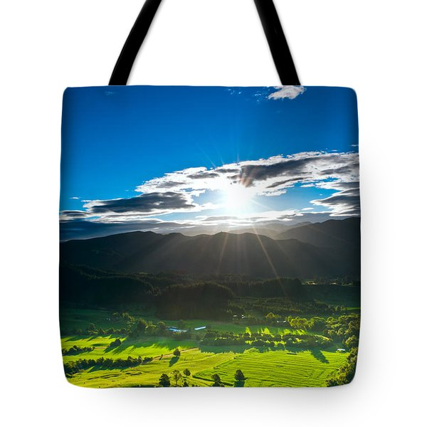 Sunrays Flood Farmland During Sunset Tote Bag