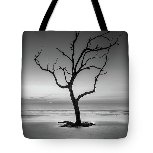 Tote Bag featuring the photograph Sunrise And A Driftwood Tree In Black And White by Greg Mimbs