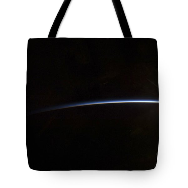 Sunrise As Viewed In Space Tote Bag by Stocktrek Images