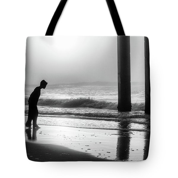 Tote Bag featuring the photograph Sunrise Boy In Foggy Beach by John McGraw