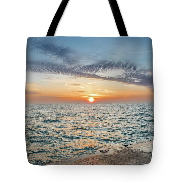 Tote Bag featuring the photograph Sunrise Over Lake Michigan by Peter Ciro