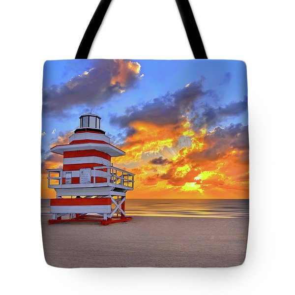 Tote Bag featuring the photograph Sunrise Over Lifegaurd Stand On South Miami Beach  by Justin Kelefas
