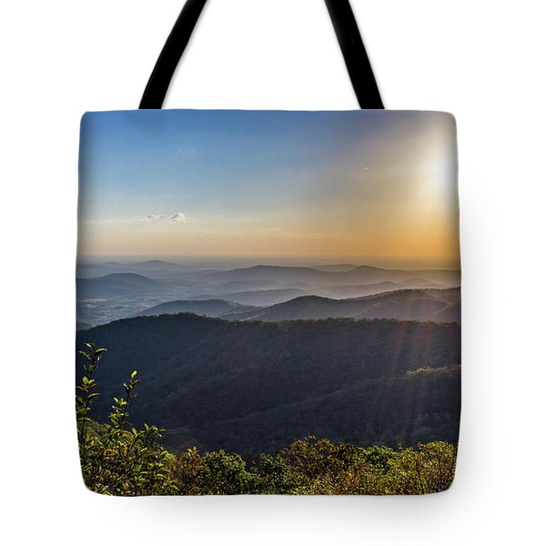Tote Bag featuring the photograph Sunrise Over The Misty Mountains by Lori Coleman