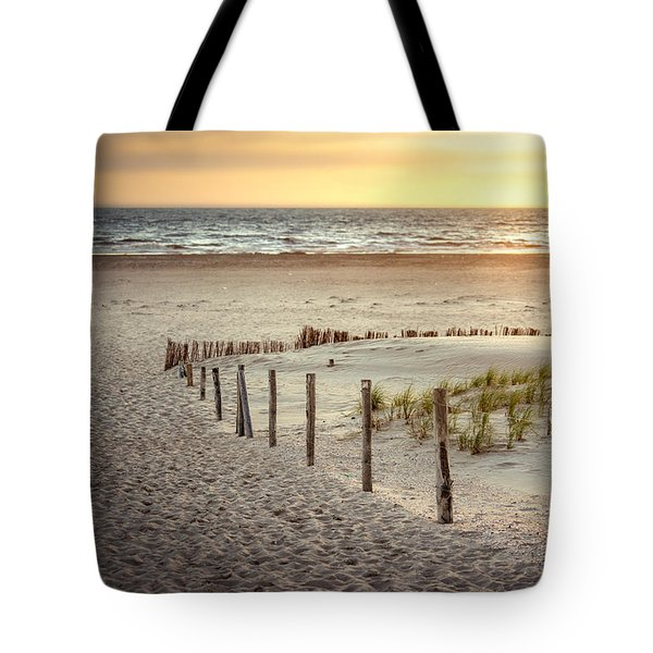 Tote Bag featuring the photograph Sunset At The Beach by Hannes Cmarits