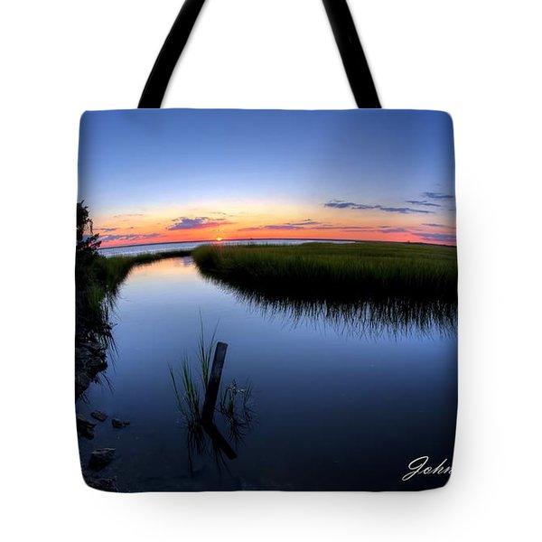 Sunset At The Landing Tote Bag by John Loreaux