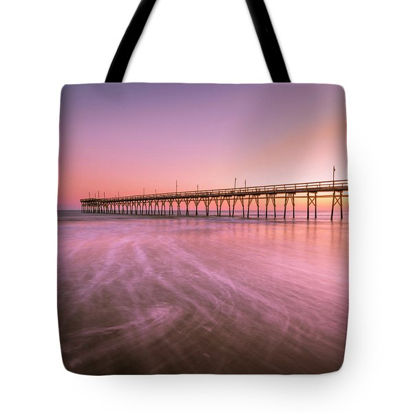 Tote Bag featuring the photograph Sunset Beach Fishing Pier In The Carolinas At Sunset by Ranjay Mitra