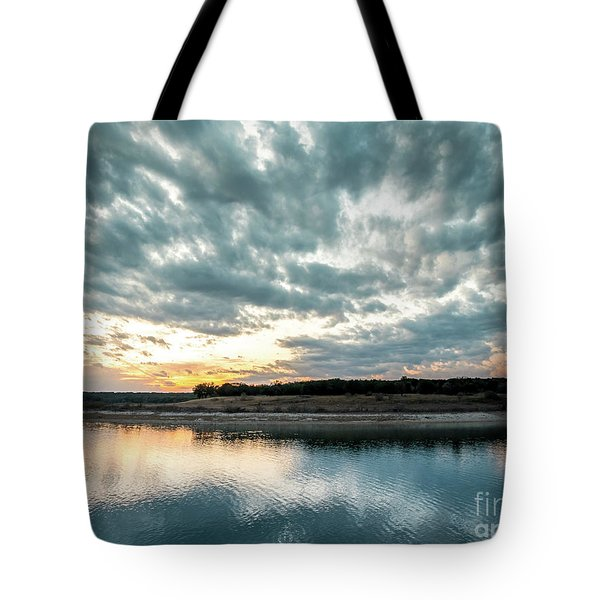 Sunset Behind Small Hill With Storm Clouds In The Sky Tote Bag