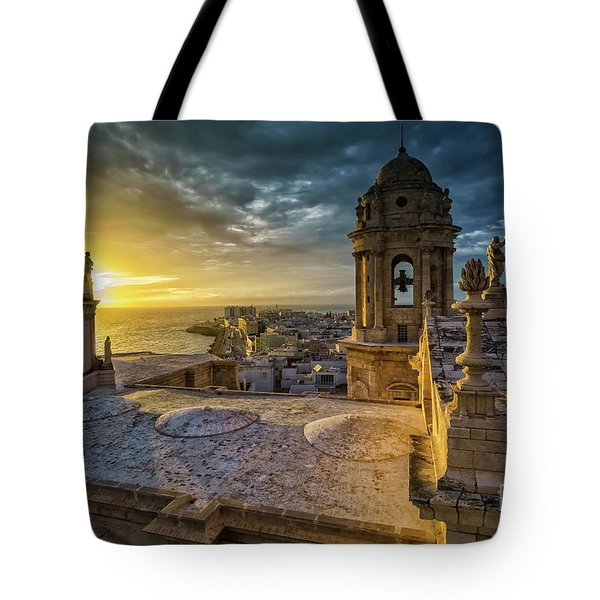 Tote Bag featuring the photograph Sunset In Cadiz Cathedral View From Levante Tower Cadiz Spain by Pablo Avanzini