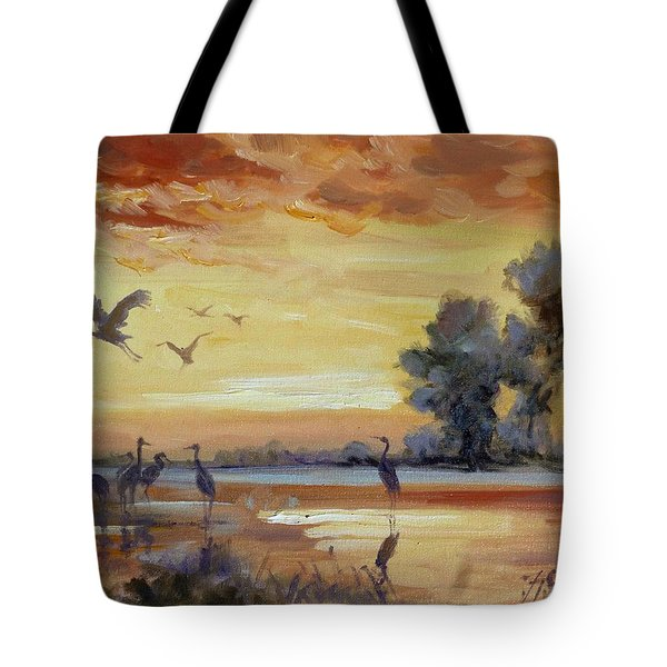 Sunset On The Marshes With Cranes Tote Bag by Irek Szelag