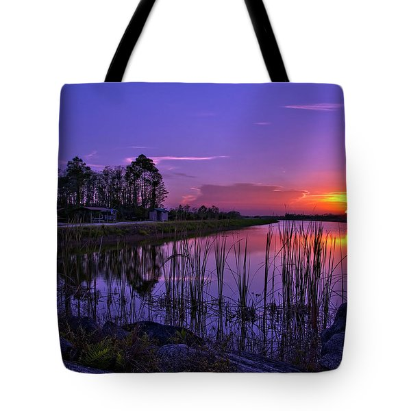 Tote Bag featuring the photograph Sunset Over Hungryland Wildlife Management Area by Justin Kelefas