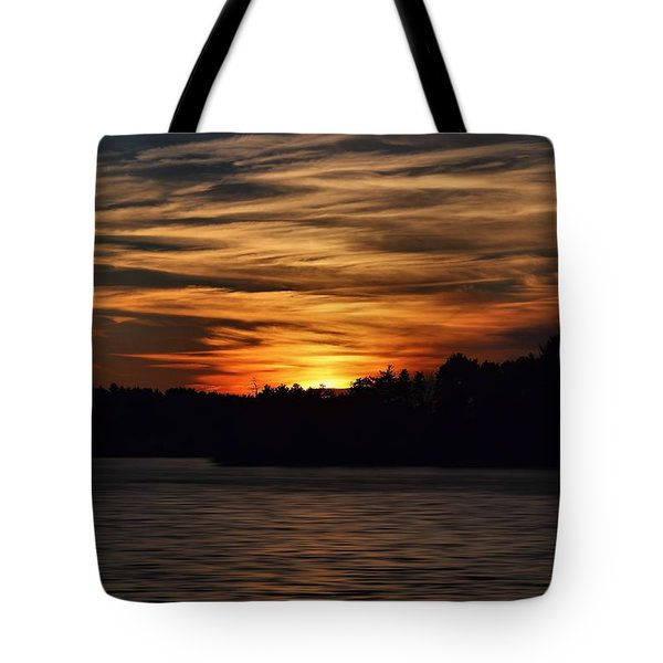 Tote Bag featuring the photograph Sunset Over Water by Kenny Glotfelty