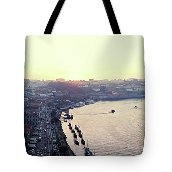 Tote Bag featuring the photograph sunset panorama of the Douro river in Porto, Portugal by Ariadna De Raadt