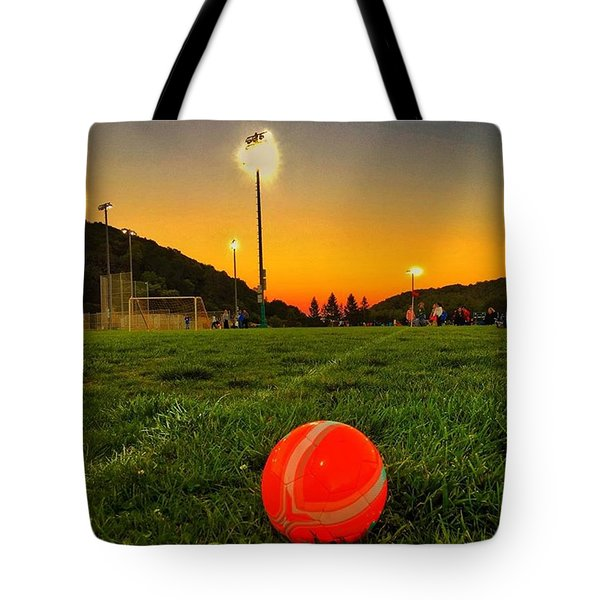 Sunset Soccer Game Tote Bag