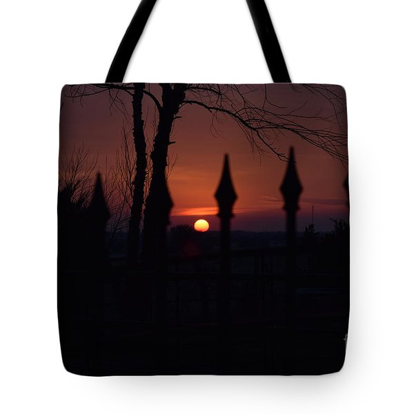 Sunset Through The Fence Tote Bag