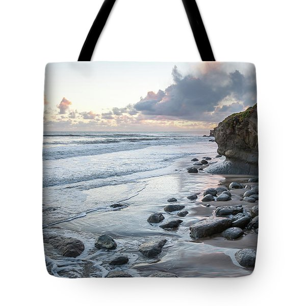 Sunset View In The Distance With Large Rocks On The Beach Tote Bag