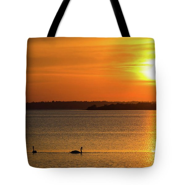 Tote Bag featuring the photograph Sunset With Swan Silhouettes by Kennerth and Birgitta Kullman