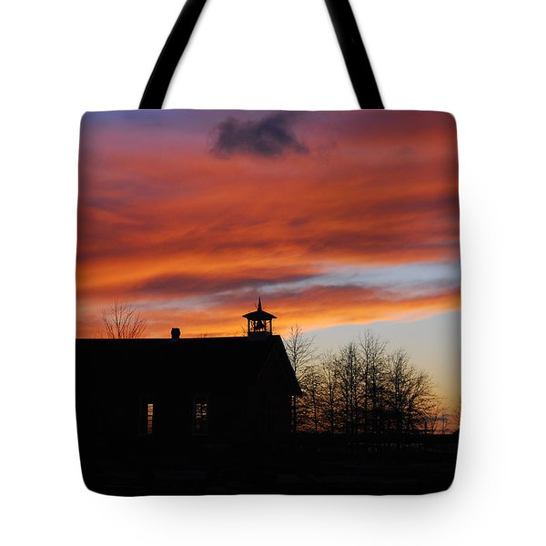 Sunsetting Behind The Historic Schoolhouse. Tote Bag