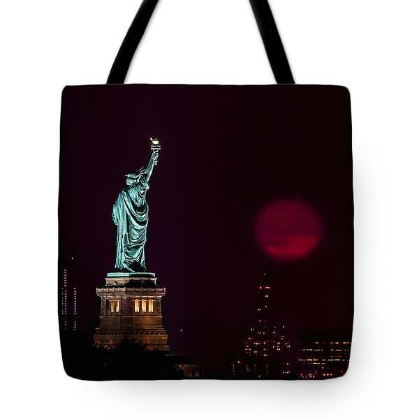 Super Moon Rising And The Statue Of Liberty Tote Bag