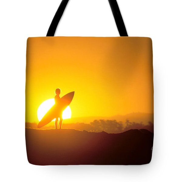 Surfer Silhouetted At Sun Tote Bag by Erik Aeder - Printscapes