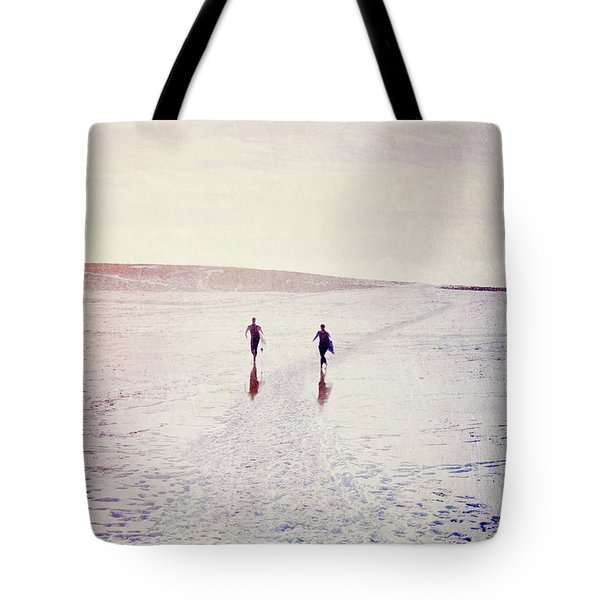 Tote Bag featuring the photograph Surfers In The Snow by Lyn Randle
