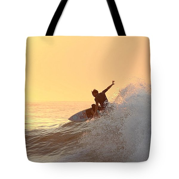 Tote Bag featuring the photograph Surfing In Golden Sky by Robert Banach