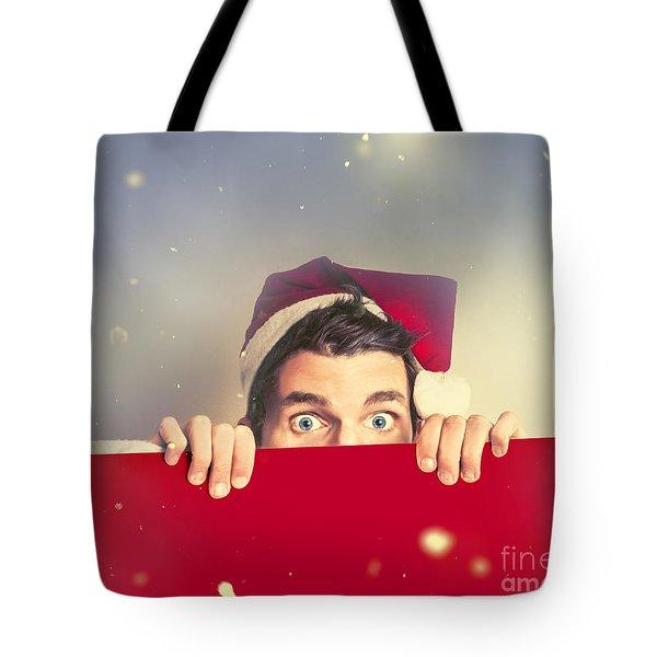 Surprised Santa Elf Holding Red Christmas Board Tote Bag