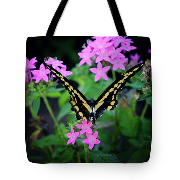 Tote Bag featuring the photograph Swallowtail Butterfly Rests On Pink Flowers by Toni Hopper