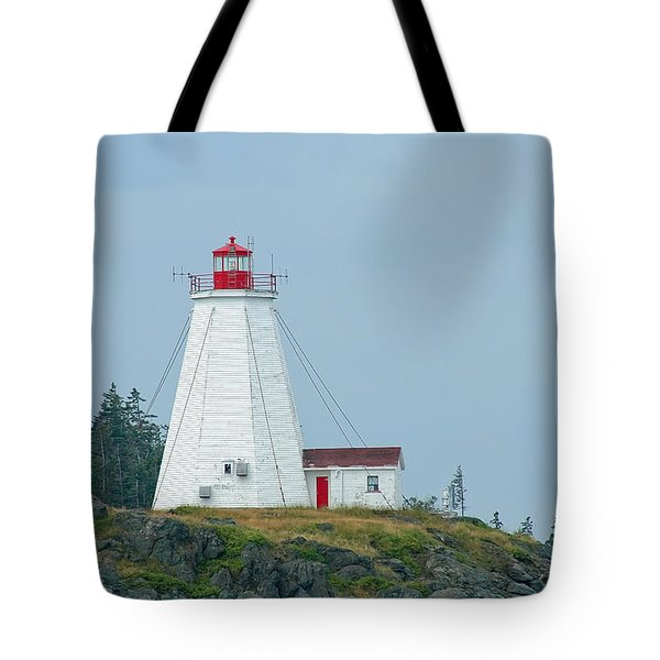 Swallowtail Lighthouse Tote Bag by Thomas Marchessault