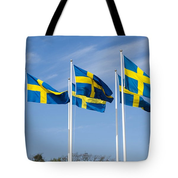Tote Bag featuring the photograph Swedish Flags by Kennerth and Birgitta Kullman