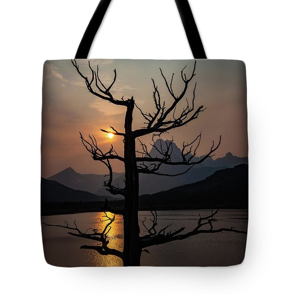 Tote Bag featuring the photograph Swiftcurrent Sunset by Lon Dittrick