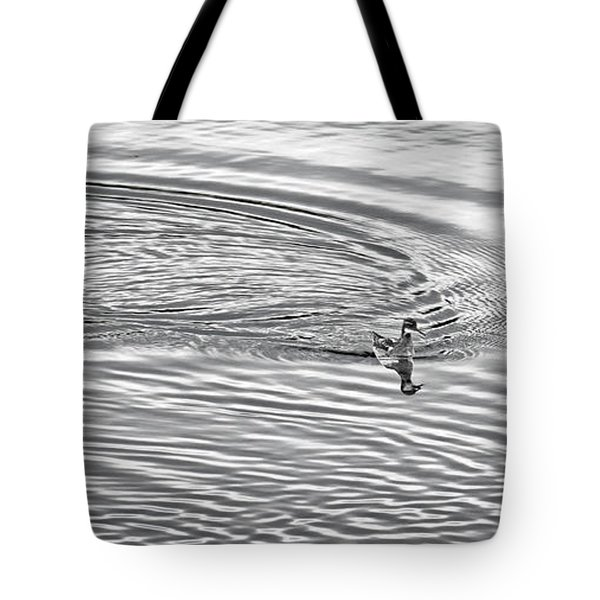 Tote Bag featuring the photograph Swimming From Circles by Joe Bonita