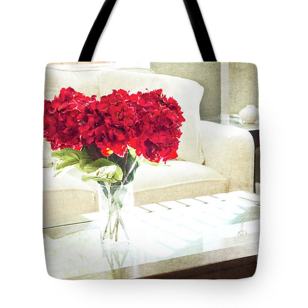 Table With Red Flowers Tote Bag