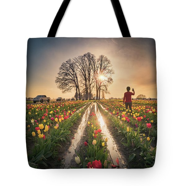 Tote Bag featuring the photograph Taking Sunset Pictures Using A Mobile Phone by William Lee