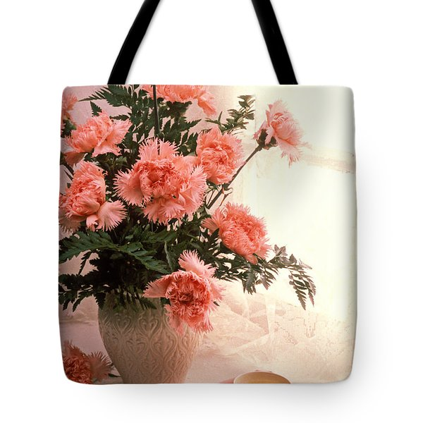 Tea Cup With Pink Carnations Tote Bag by Garry Gay