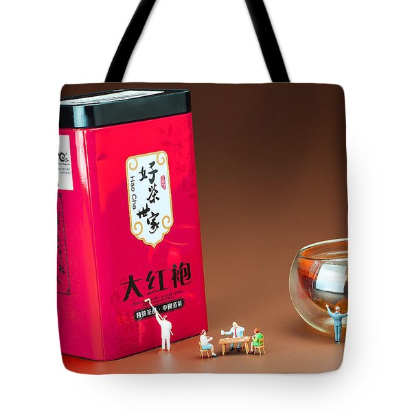 Tote Bag featuring the photograph Tea Drinking In A Family Little People Big World by Paul Ge